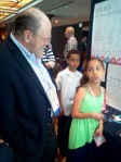 NMC CEO Larry Johnson chats with one of the youngest conference presenters